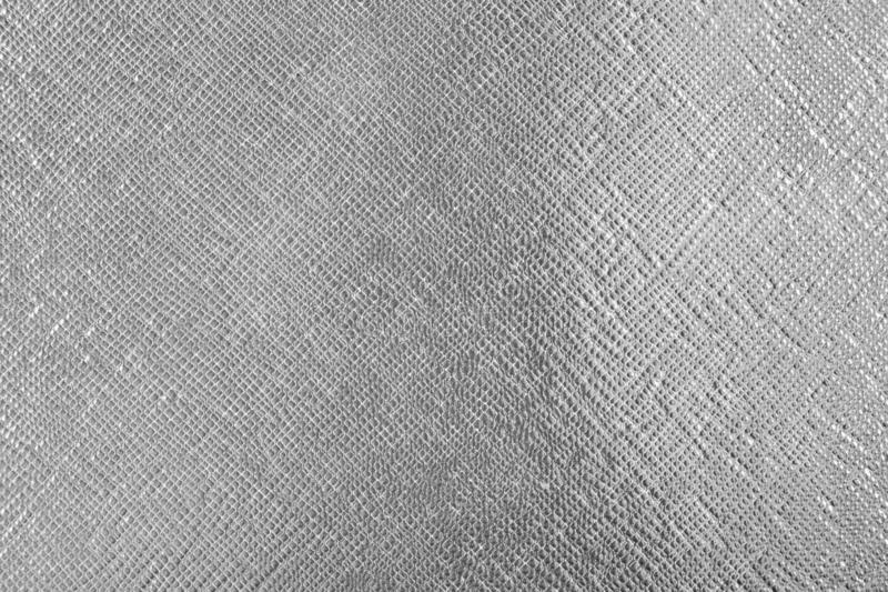 Fond avec le matériel en cuir d'argent d'aluminium, fin image de photo vers le haut d'†« images libres de droits