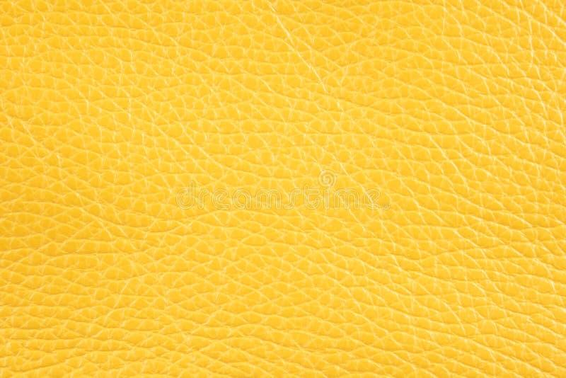 Fond avec le similicuir jaune ensoleillé, fin image de photo vers le haut d'†« image stock