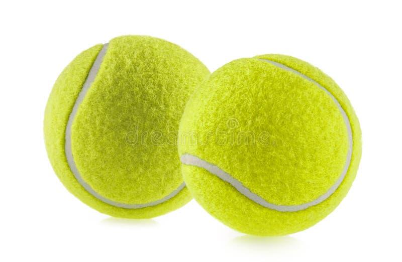 Fond blanc d'isolement par balle de tennis - photographie image stock