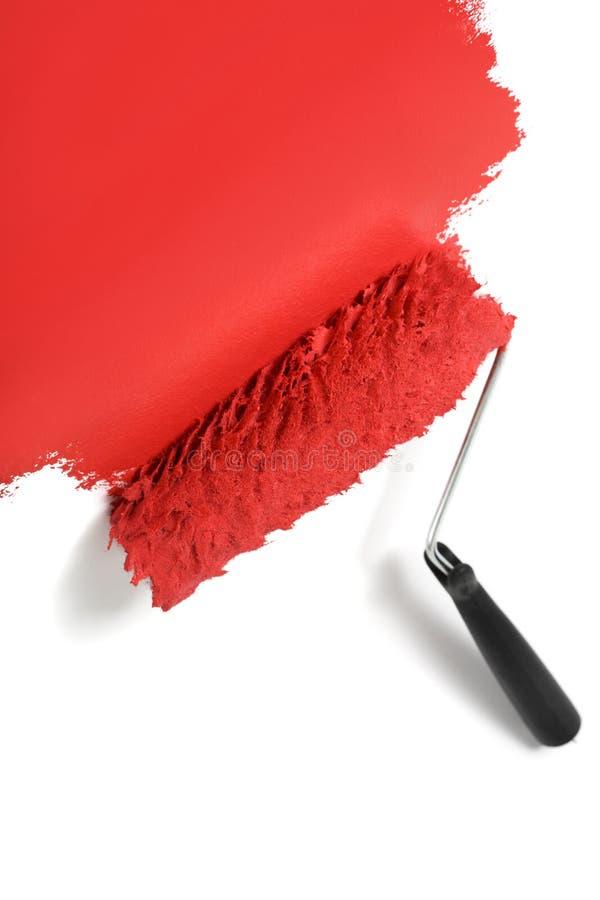 Fond blanc de peinture de rouleau de peinture rouge photographie stock