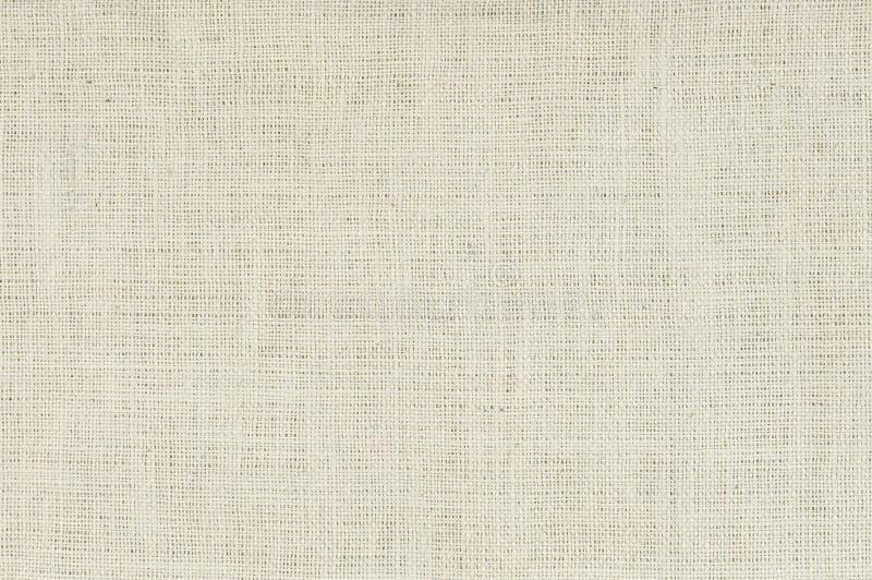 Fond blanc de toile de jute photo stock