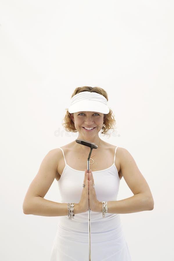 Fond blanc de yoga de golfeur heureux de femme photos libres de droits
