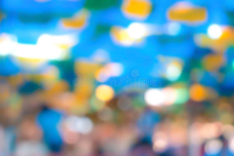 Fond bleu avec le bokeh autour, et couleur de blanc, de vert, de turquoise, d'orange, jaune, et de pêche dans elle illustration stock