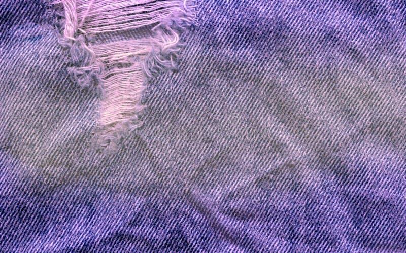 Fond bleu de Jean Texture de denim Texture de tissu déchirée par jeans image libre de droits