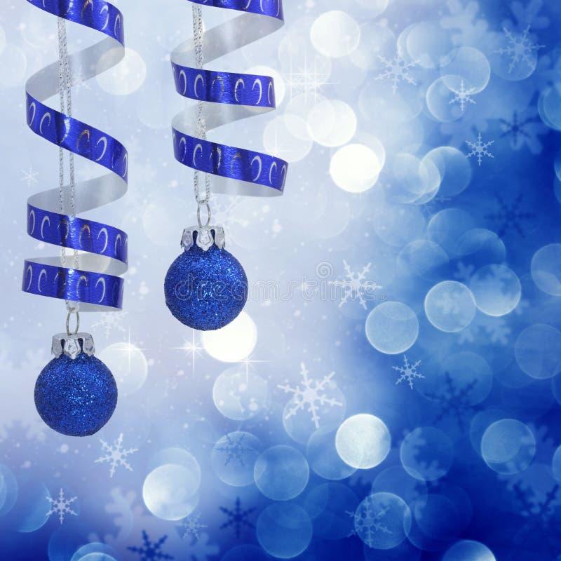 Fond bleu de lumières de Noël image stock