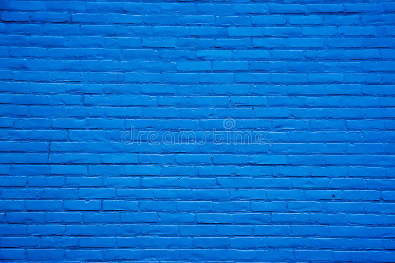 Fond bleu de mur de briques images stock