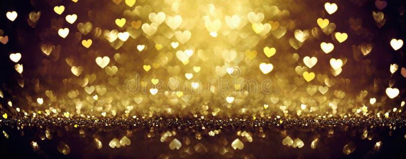 Fond brillant d'or avec des coeurs photo stock