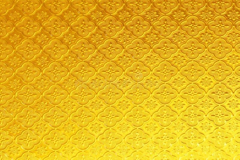 Fond brillant de texture en verre souillé d'or jaune photographie stock libre de droits