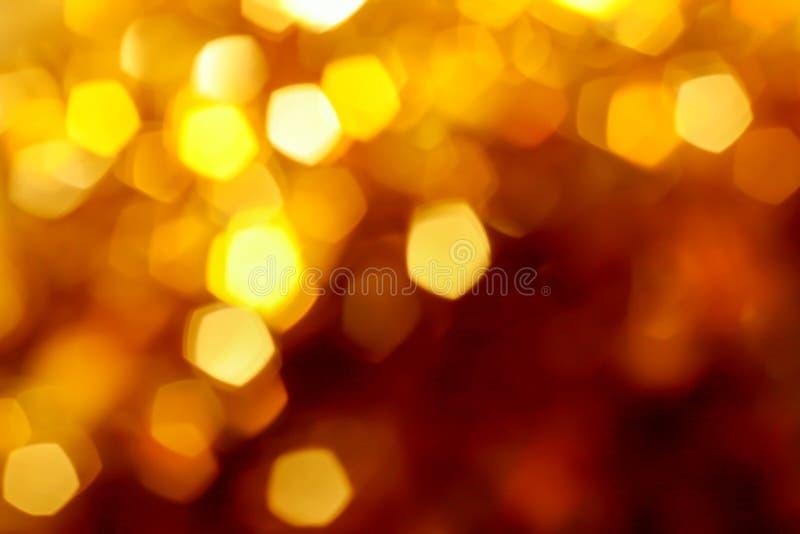 Fond brouillé abstrait de bokeh, jaune, or, orange, de fête, Noël, partie image libre de droits