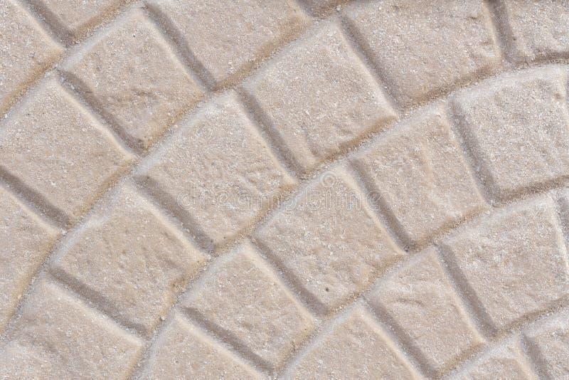 Fond carrelé beige de texture de trottoir photographie stock