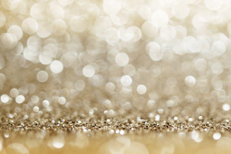 Fond circulaire defocused de couleurs d'or et jaunes de bokeh de résumé Lumière de Noël, nouvelle année ou saison Fond de salutat image libre de droits