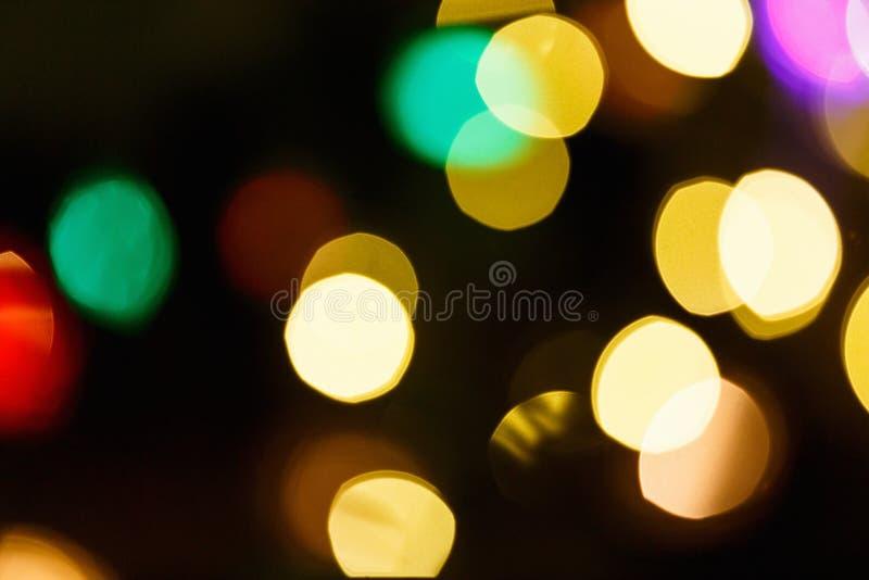 Fond clair abstrait de célébration avec les lumières d'or defocused pour Noël, nouvelle année, vacances photos libres de droits