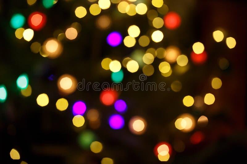 Fond clair abstrait de célébration avec les lumières d'or defocused pour Noël, nouvelle année, vacances photos stock