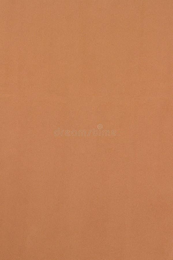 Fond clair de texture de mur de stuc de brun de sienne images stock