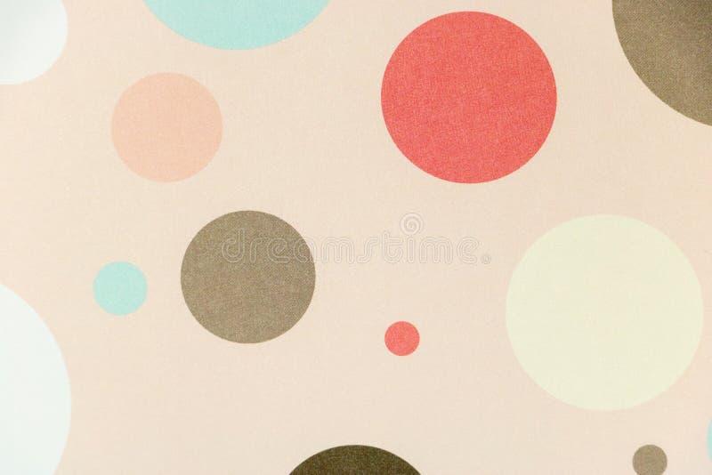 Fond coloré de pois sur le fond rose mou Enfance thématique photo libre de droits