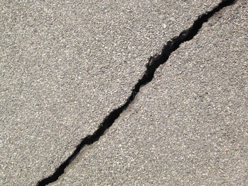 Fond criqué d'asphalte image stock