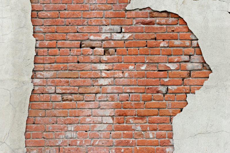 Fond déchiré de mur de briques photos stock