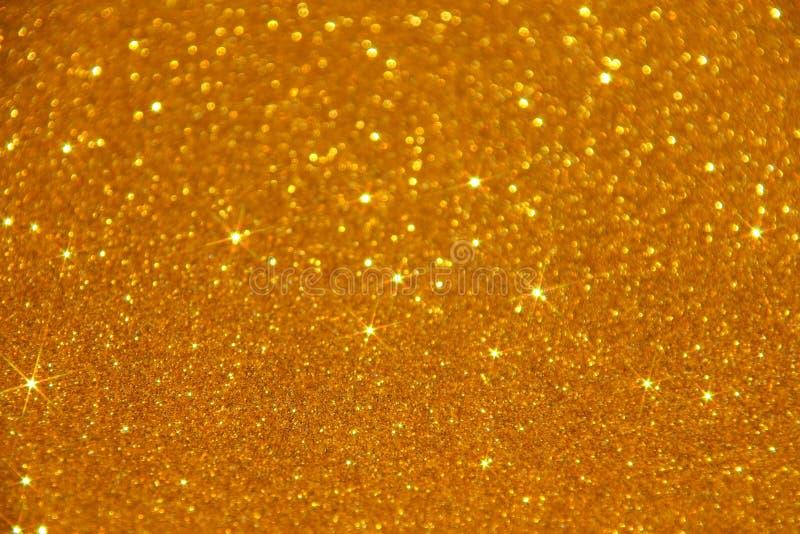Fond d'étincelle d'étoiles de scintillement d'or - photo courante image stock