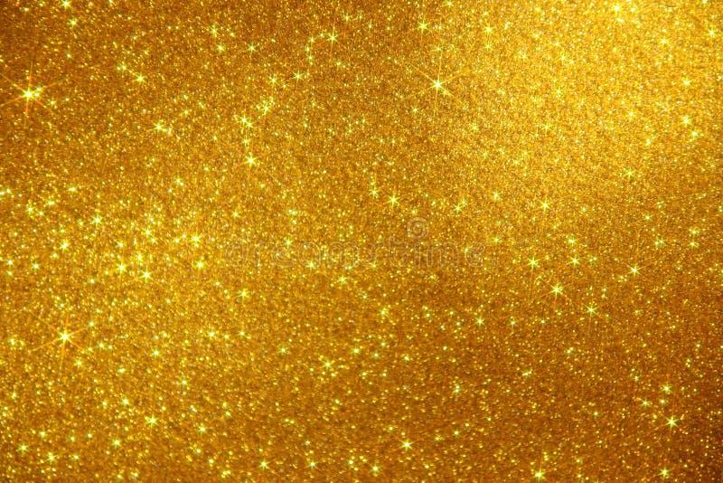 Fond d'étincelle d'étoiles de scintillement d'or - photo courante photos libres de droits