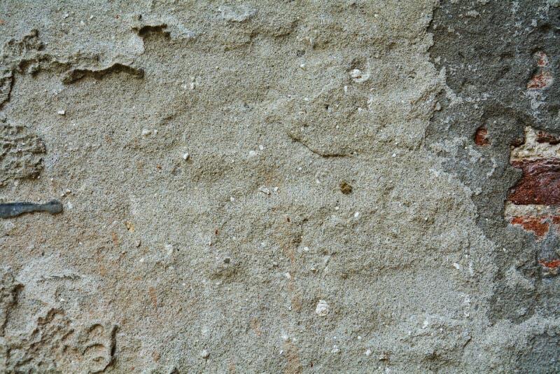 Fond d'abrégé sur mur, merdes et trous verts gris en pierre, fond abstrait photos stock