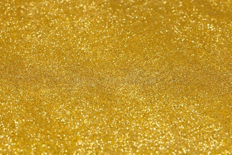 Fond d'abrégé sur Noël de texture de scintillement d'or photo libre de droits