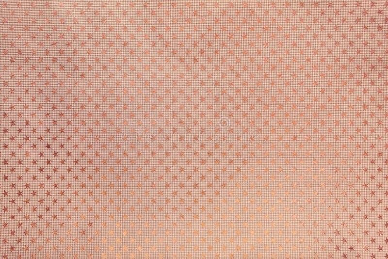 Fond d'or de Rose du papier d'aluminium en métal avec un profil sous convention astérisque images stock