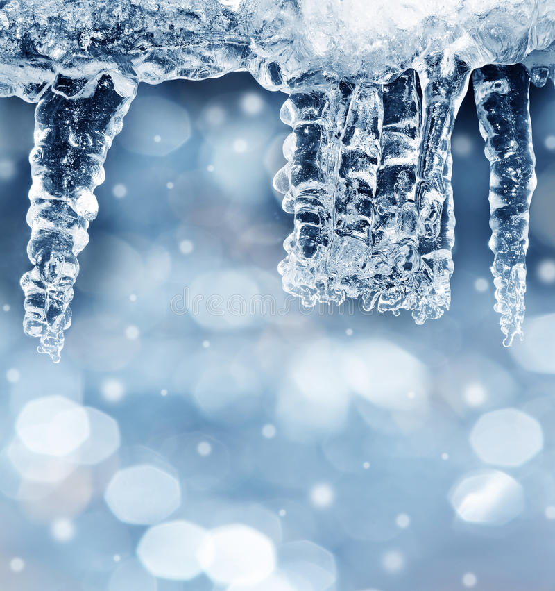 Fond d'hiver avec des glaçons photographie stock