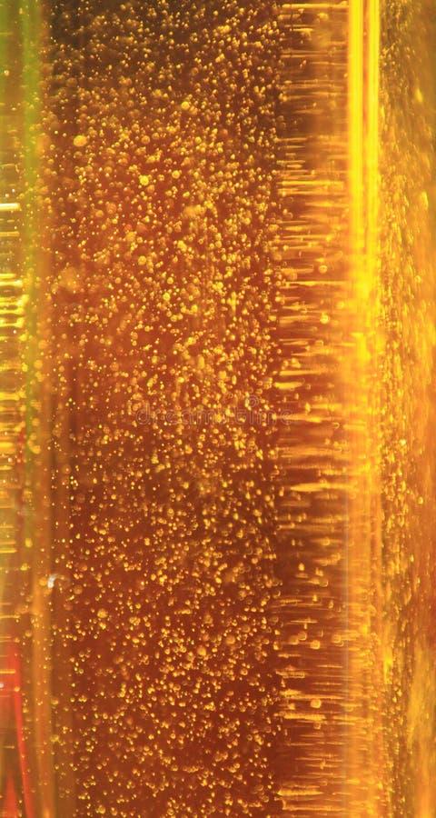 Fond d'Olive Oil Golden Blurred Bubbles images libres de droits