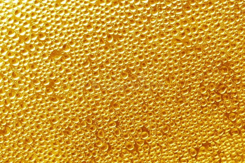 Fond d'or - photos courantes de baisses photo stock