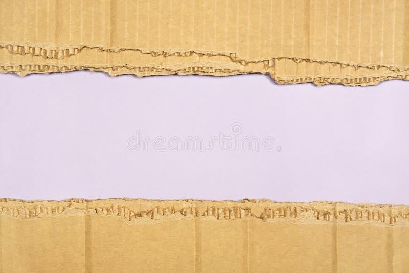 Fond d'un papier avec les bords déchirés images stock