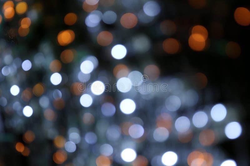 Fond de Bokeh coloré du Joyeux Noël, éclat d'éclairage de bokeh de bonne année sur le fond de nuit, lumière de scintillement de B photos stock