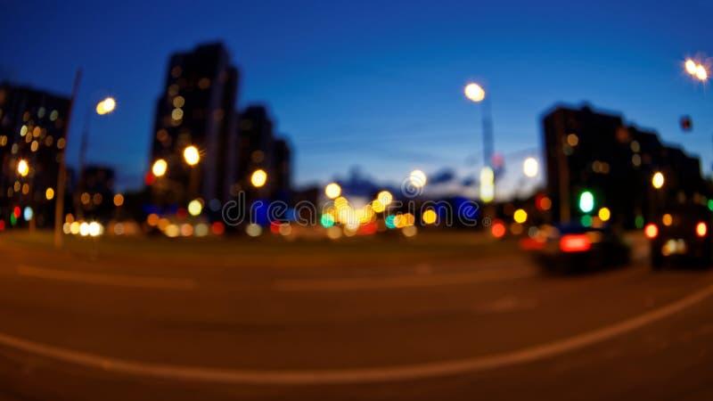 Fond de Bokeh de route de nuit de ville images libres de droits