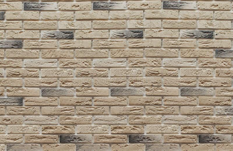 Fond de brun de maçonnerie et de briques de scories beiges sur le mur, qui sont employées dans la réparation des lieux photographie stock libre de droits