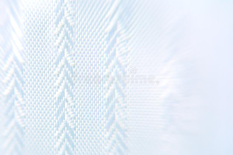 Fond de couleur bleue avec la texture géométrique du tissu sous forme de sapin photographie stock