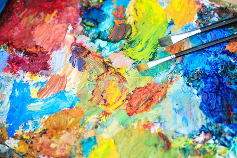 Fond de couleur de la palette de l'artiste avec des brosses photo libre de droits