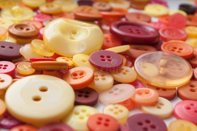 Fond de couture coloré de boutons photographie stock libre de droits