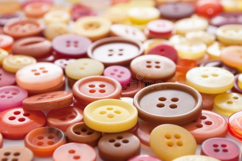 Fond de couture coloré de boutons photos libres de droits