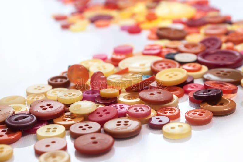 Fond de couture coloré de boutons images libres de droits