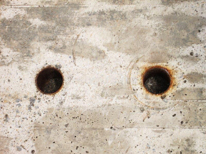 Fond de couvercle d'égout de ciment photos stock