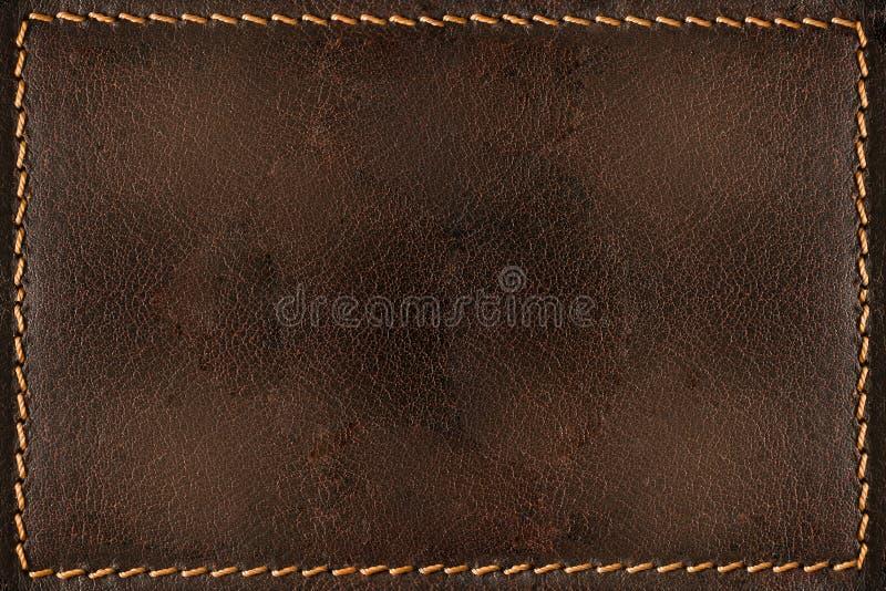 Fond de cuir de Brown avec des coutures photo stock