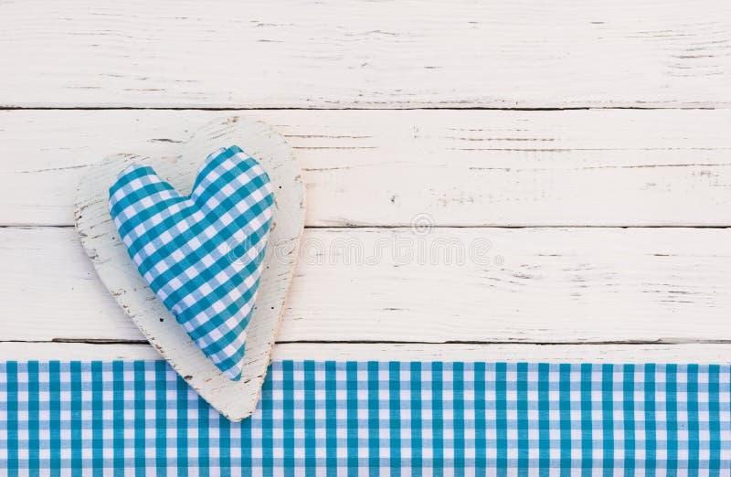 Fond de fête de naissance avec le coeur bleu pour un garçon photographie stock
