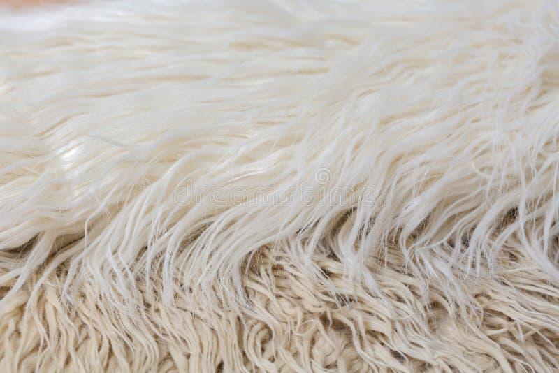 Fond de fourrure artificielle blanc, brun, beige, crème images libres de droits