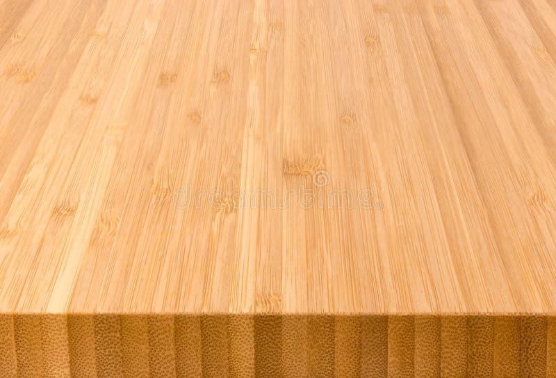 Fond de la planche à découper en bambou de la bout-fin images stock