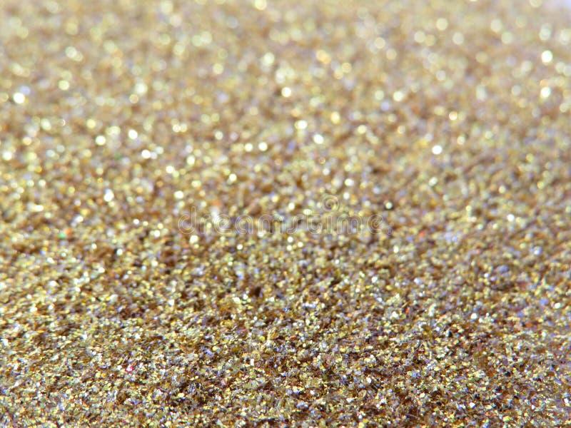 Fond de la poussière et de sable d'or de scintillement pour des cartes de voeux de Noël photos stock
