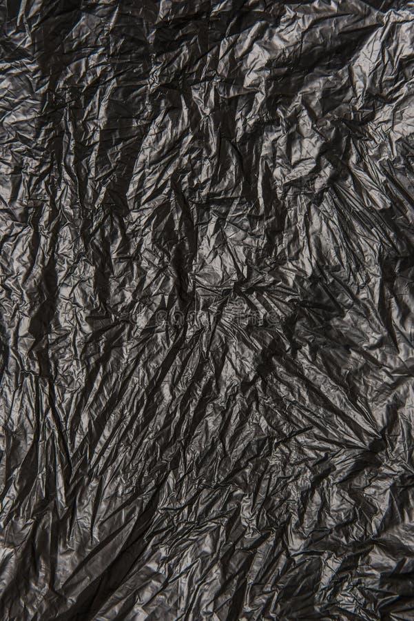Fond de la surface en plastique texturisée noire image stock
