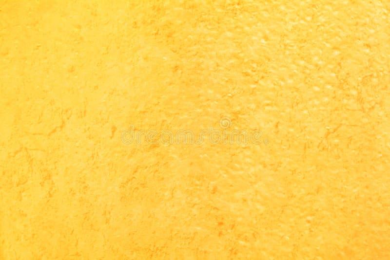 Fond de luxe de conception de texture solide légère grunge d'or image stock