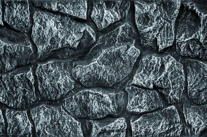 Fond de mur en pierre - caractéristique de bâtiment Texture du mur épais et fort des pierres rugueuses de diverses formes et tail images stock