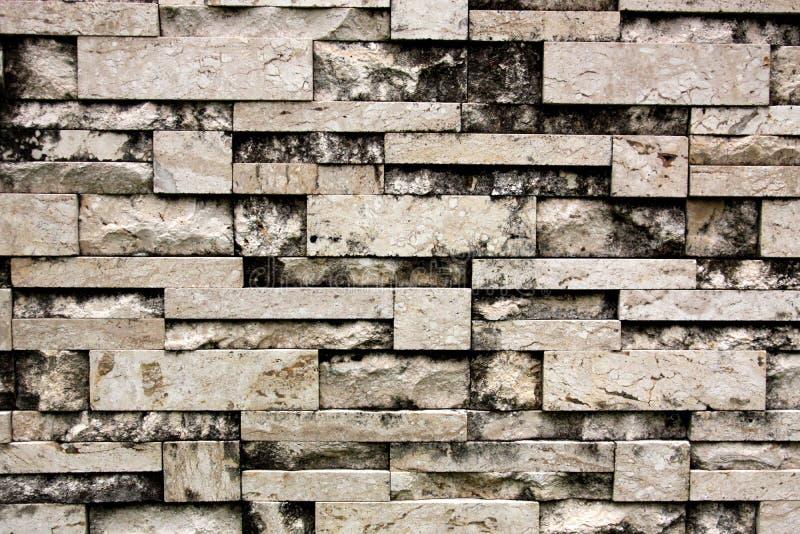 Fond de mur en pierre Mur en pierre qui combine beaucoup de types de pierre ensemble Texture sans joint photo stock