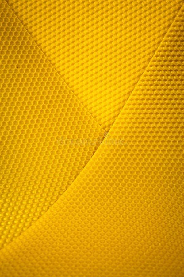 Fond de nid d'abeilles jaune de cire images libres de droits
