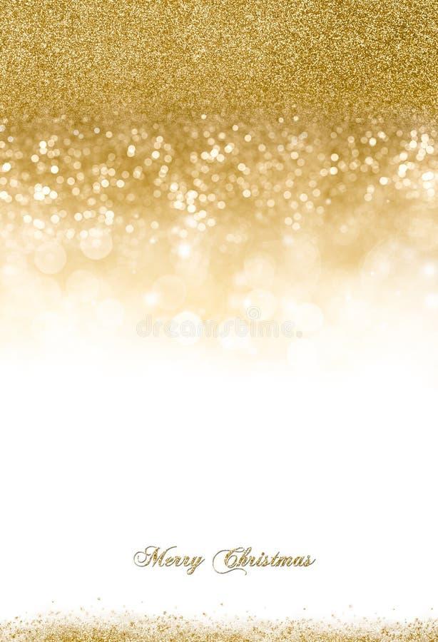 Fond de Noël avec le scintillement d'or dispersé image libre de droits